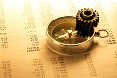 Operating budget, cogwheel and compass Stock Photo