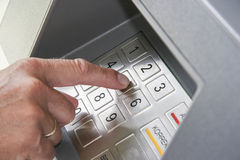 Operating the cash dispenser. Insert the secret number on a cash dispenser Stock Images