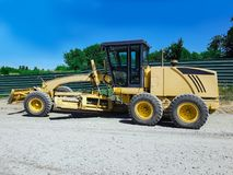 Operating construction equipment, working machinery. Yellow combine harvester Stock Images