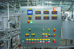 Operating control panel at dairy plant stock photo