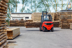 Operating Forklift Truck In Lumber Industry Royalty Free Stock Photo