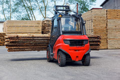 Operating Forklift Truck In Lumber Industry Stock Photo