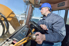 Operating heavy building equipment. Operating a heavy building equipment stock images