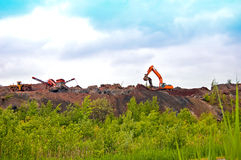 Operating heavy machinery digging Royalty Free Stock Photo