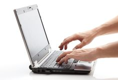 Operating a laptop. This is a picture of a person is operating a laptop Royalty Free Stock Photo