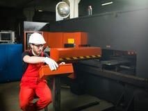 Operating a machinery Stock Image