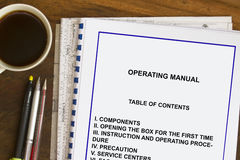 Operating manual. Instruction and operating manual with coffee and documents stock photos