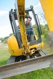 Operating a mini digger. Digger stock images