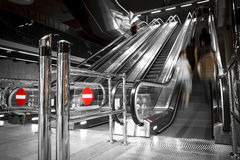 Operating a modern escalator at a station Stock Photo