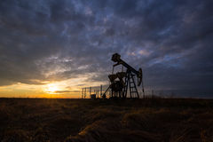 Free Operating Oil And Gas Well And Sunset Sky Stock Images - 78339414