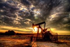 Operating oil and gas. Sunset on the oil field in flat Slavonia Stock Image