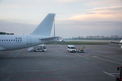 The operating personnel are preparing aircraft before departure. Royalty Free Stock Photos