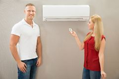 Operating remote control of an air conditioner Stock Photos