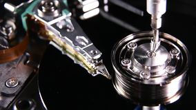 Hard drive internal. Operating and repair of  hard disk internals stock video footage