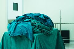 Operating room green clothes after finishing surgery. In operating room royalty free stock photo