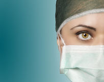 Operating room nurse. Young nurse in the operating room with green eyes Royalty Free Stock Image