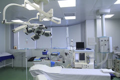 Operating Room Before Surgery. Operating room with covered table, different medical equipment, clean and prepared for the surgery stock photography