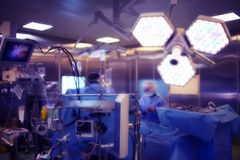 Operating room with working doctor`s team during surgical proced royalty free stock photo