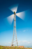 Operating wind turbine. A wind turbine spinning during a windy day Stock Photos