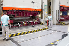 Operating workers on hydraulic press Stock Photos