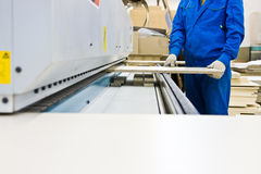 Operating working with wood paneling machine Royalty Free Stock Photos