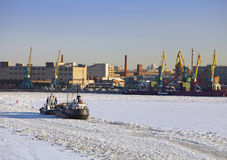 Operation of the auxiliary ships in seaport of St. Petersburg during winter navigation. Russia Royalty Free Stock Photo