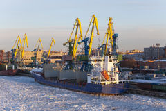 Operation of the auxiliary ships in seaport of St. Petersburg during winter navigation. Russia Stock Images