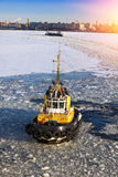 Operation of the auxiliary ships in seaport of St. Petersburg during winter navigation. Russia Stock Photography