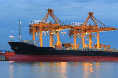 Operation of crane and cargo ship Stock Images