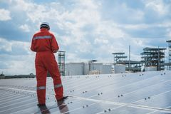 Operation and maintenance in solar power plant ; engineering tea. M working on checking and maintenance in solar power plant ,solar power plant to innovation of royalty free stock photos