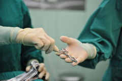 The operation room transfer gesture. In a modern operation room, plate placed in need an operation instrument royalty free stock images