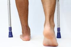 Operation scar of Achilles tendon rupture and crutchs. Japanese Stock Image