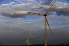 Wind power generation. At the edge of the tidal flat in the field Many wind turbines in operation Royalty Free Stock Images