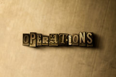 OPERATIONS - close-up of grungy vintage typeset word on metal backdrop. Royalty free stock illustration.  Can be used for online banner ads and direct mail Stock Images