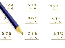 Operations to multiply. Several operations to multiply with a pencil Royalty Free Stock Photo