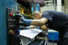 Operative manipulating printing machine stock photos