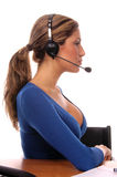 Operator. Sexy Latino woman as a corporate operator, with a wireless headset Royalty Free Stock Images