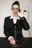 Operator. Retro switchboard operator with vintage candlestick phone answering a call stock images