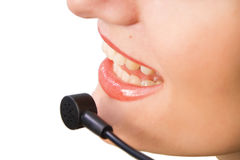 Operator of a call center or customer service. Closeup isolated on white stock images