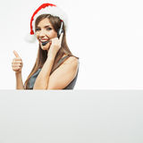 Operator call center woman , christmas Santa hat . Stock Photography