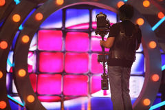 Operator with camera stand on stage Royalty Free Stock Images