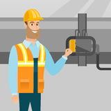 Operator checking detector on gas pipeline. Royalty Free Stock Images