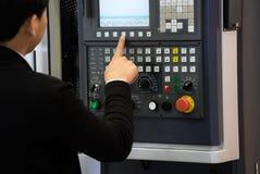 Operator of CNC machine Stock Photo