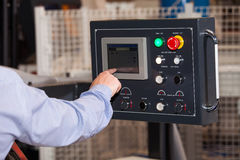 Operator of CNC machine. Operator hands on lcd screen of CNC machine Royalty Free Stock Images