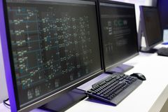Operator console in a control room. Operator console of SCADA system in a control room. Selective focus stock photography