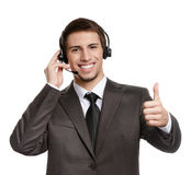 Operator with earphones thumbs up Stock Images