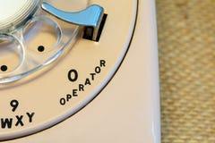 0 operator 911 emergency. 0 for operator on cream rotary telephone Royalty Free Stock Photos