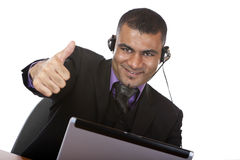 Operator express happiness showing thumb up Stock Photo