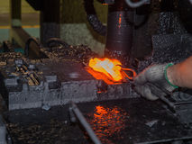 Operator forging steel automotive parts Stock Photos