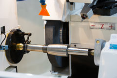 Operator grinding and inspection high precision automotive part Stock Photo